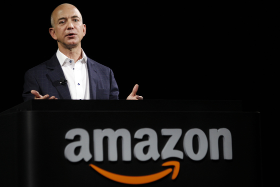 Jeff Bezos, chief executive officer of Amazon.com Inc., introduces the Kindle Fire HD tablets at a news conference in Santa Monica, California, U.S., on Thursday, Sept. 6, 2012. Amazon.com Inc. is updating its line of Kindle e-readers and tablets in a bid to stoke consumer demand as Google Inc. and Microsoft Corp. join the crowded market of machines challenging Apple Inc.s iPad. Photographer: Patrick Fallon/Bloomberg *** Local Caption *** Jeff Bezos