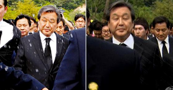 지난 2013년 5월 23일 당시 새누리당 대표였던 김무성 바른정당 의원이 추도식이 끝나고 퇴장하던 중 참석자들로부터 날아든 물병에서 나온 물을 맞고 있다. [연합]