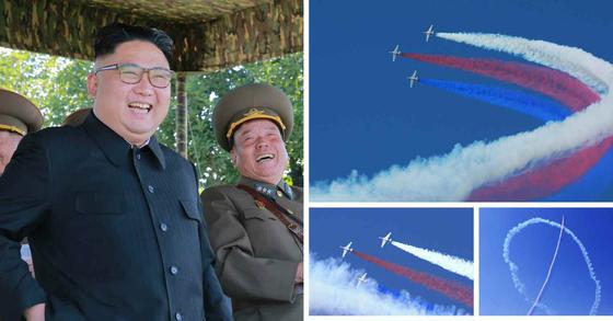 """<yonhap photo-1221="""""""""""""""""""""""""""""""">북한군은 4일 김정은이 참관한 가운데 '항공 및 반항공군 비행지휘관들의 전투비행술 경기대회-2017'을 진행했다. 사진은 조종사들의 비행 모습을 지켜보는 김정은. [사진 연합뉴스]</yonhap>"""