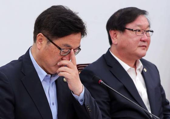더불어민주당이 9일 국회에서 정책조정회의를 열었다. 우원식 원내대표(왼쪽)와 김태년 정책위의장. 박종근 기자