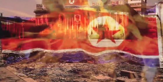 지난 5일 군 당국은 가상 평양타격 장면 등 '참수작전' 영상을 대거 공개했다.평양 김일성광장이 초토화되고 인공기가 불타는 장면.[합참 제공=연합뉴스]
