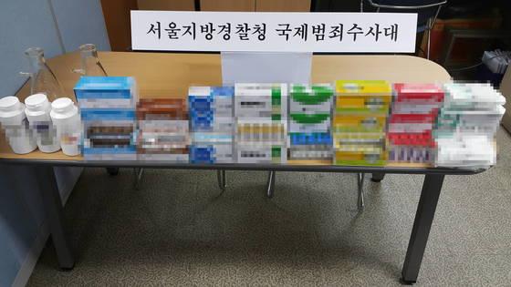 말기 암환자들을 속여 불법 의료행위를 하고 3억원을 받아 챙긴 김모(56)씨 일당이 경찰에 붙잡혔다. 이들은 전문의약품 등을 합성해 만든 가짜약을 '암 완치 신약'이라고 속였다. [사진 서울지방경찰청 국제범죄수사대]
