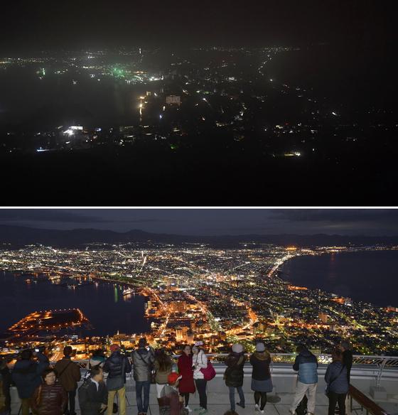 6일 밤 정전사태로 암흑이 된 하코다테의 야경(위). 아래는 일본 3대 야경으로 꼽힐 정도로 아름다운 하코다테의 야경. 2015년 11월 촬영.[AP=연합뉴스]
