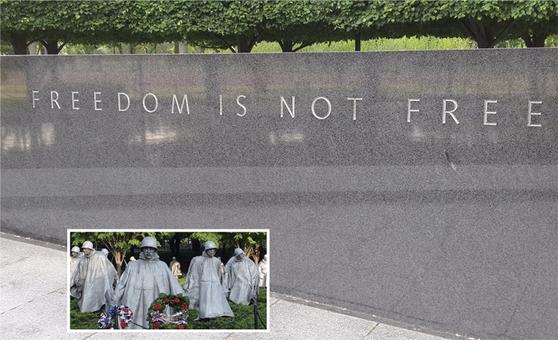 워싱턴DC에 있는 한국전쟁 참전 공원 기념비와 참전용사 조각상.