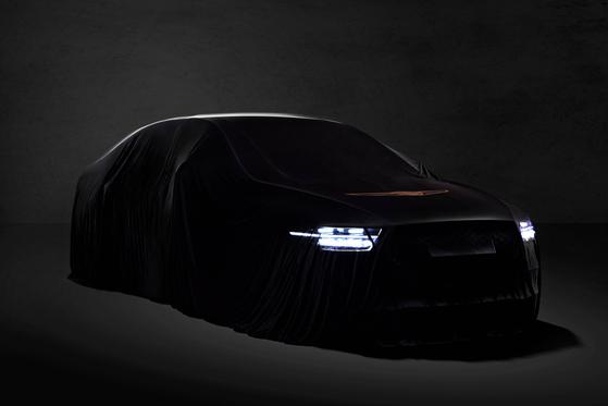 제네시스 브랜드가 오는 27일 최고급 세단 G90 공식 출시한다. 이에 앞서 호기심을 유발하기 위해 차에 가림막을 씌워 공개했다. [사진 현대차]