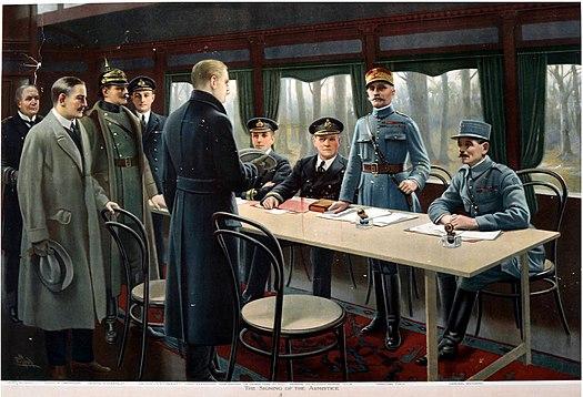 1918년 11월 11일 새벽 5시 연합군 사령부가 있던 프랑스 콩피에뉴의 숲에 있던 페르디낭 포슈 사령관의 전용 기차에서 진행된 정전 서명 사진에 색을 입힌 모습.정전 시기는 11시로 잡았다. [위키피디아]