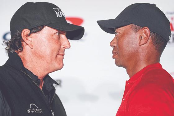 필 미켈슨(左), 타이거 우즈(右). [AFP=연합뉴스]