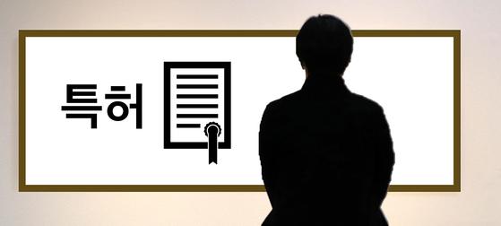 우리나라 연간 특허 출원 건수는 약 20만건에 이르지만 출원된 특허 대부분은 기업의 대표 방 한쪽 벽면에 걸려 그 역할을 다 하고 있다. [중앙포토]