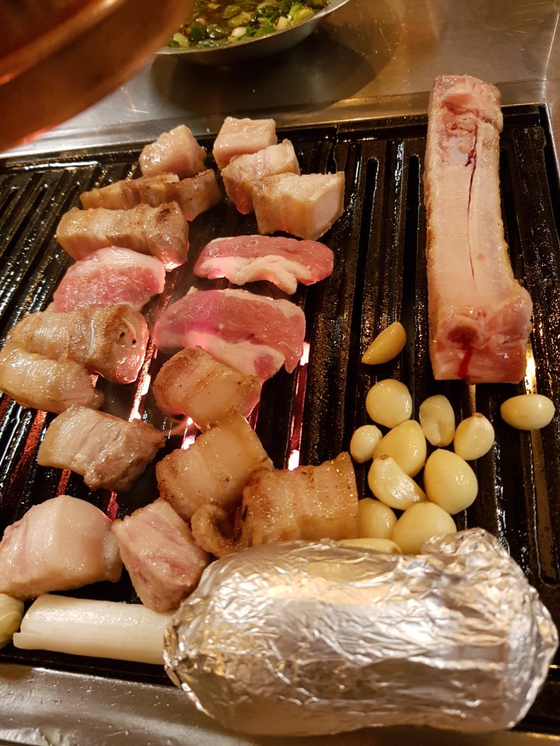 The meat is grilling. Photo by VoomVoom