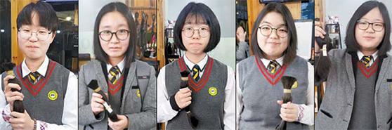 소아암 환자들에게 모발을 기증하기 위해 긴 생머리를 자른 삼우중학교 학생들. [사진 학부모]