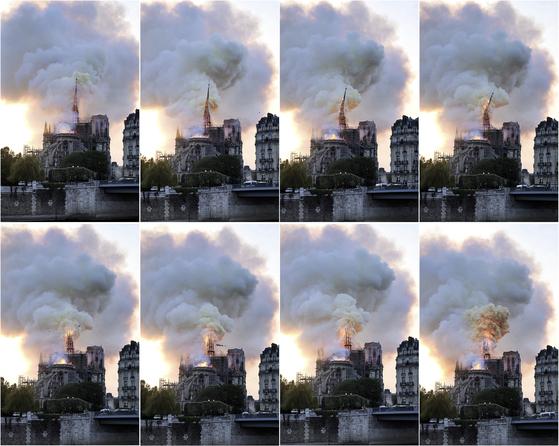 15일 저녁 노트르담 성당의 불길이 번지고 있는 모습. [AP=연합뉴스]