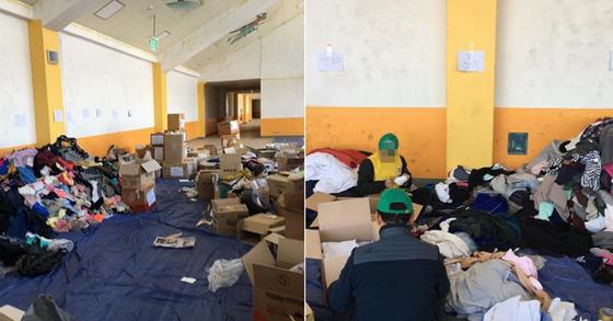 강원도 산불 자원봉사자들이 전국에서 온 구호 물품 중 헌옷을 분류하는 중이다. [자원봉사자 황씨 제공]