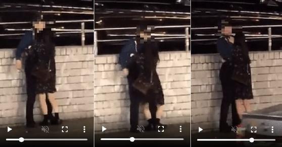 [커뮤니티 영상 캡쳐] 영상에는 여성 취객이 몸을 끌어안아도 부축하거나 손 대지 못하고 우왕좌왕하는 남성 경찰관의 모습이 담겼습니다.