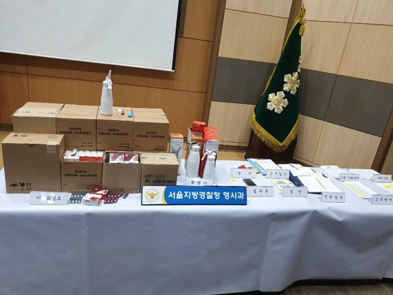 서울지방경찰청이 강남 주택가에서 25억 규모의 해피벌룬을 유통한 김모(34)씨 일당으로부터 압수한 증거물. 사진=김다영 기자