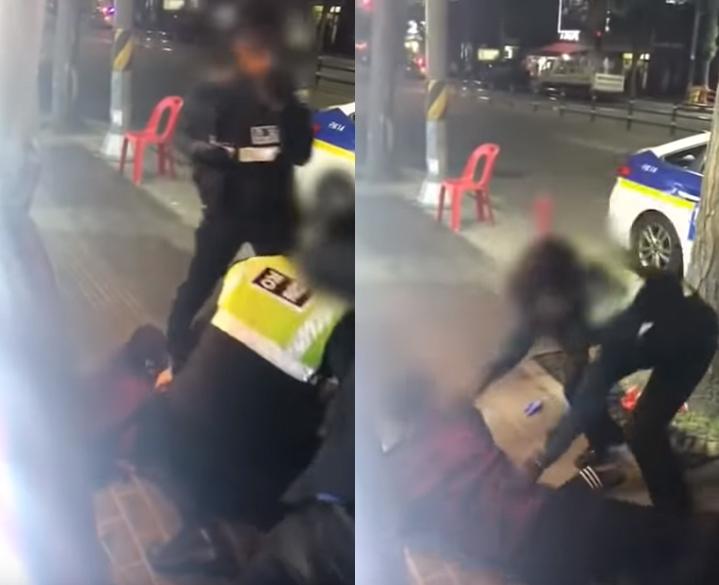 취객을 제압하는 남성 경찰 옆에 서 있는 여경, 이후 여경이 바닥에 누운 취객을 붙잡아두고 있다. [사진 유튜브]