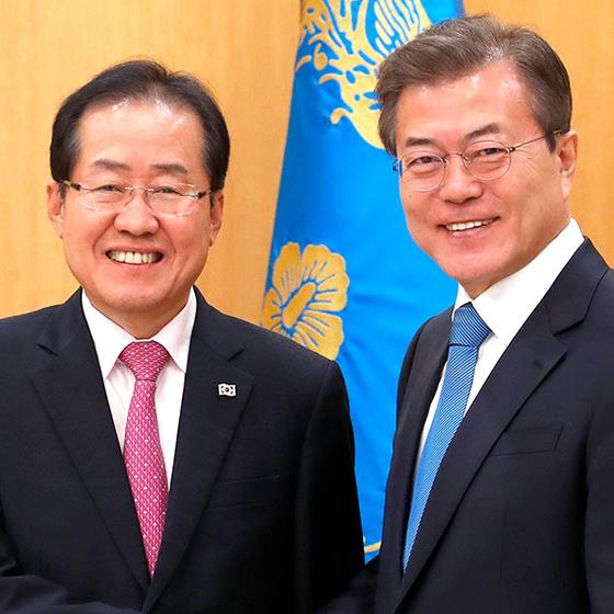 문재인 대통령과 홍준표 전 자유한국당 대표 [뉴스1]