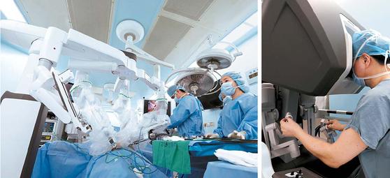 지난 4일 고대안산병원 수술실에서 송태진 교수(오른쪽 사진)의 집도로 46세 급성 담낭염 환자의 로봇 담낭절제술이 진행되고 있다. [고대안산병원]