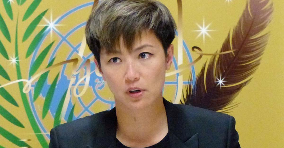 8일(현지시간) 제네바의 유엔 빌딩에서 홍콩 가수 데니스 호가 발언하고 있다. [AP=연합뉴스]
