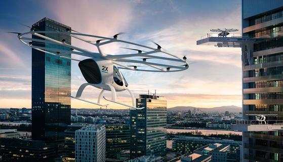 드론의 이착륙을 위해 지상 시설보다 건물 옥상을 이용하는 것이 유리하다. 인구 밀집 지역을 피해야 하고, 항공기 소음과 공기 난류 문제도 해결해야 할 문제이다. 사진은 독일의 드론제조사인 볼로콥터(volocopter)의 드론택시 이미지. [사진 volocopter]