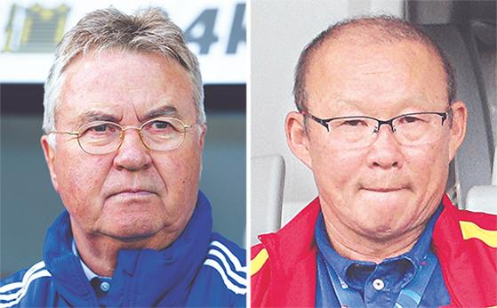 2002년 호흡을 맞췄던 히딩크(왼쪽)와 박항서. 17년 뒤 두 지도자의 운명이 엇갈렸다. [중앙포토]