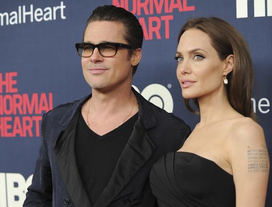 2014년 브래드 피트와 안젤리나 졸리가 HBO 행사에 참석한 단란한 모습. [AP=연합뉴스]
