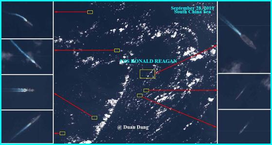 지난 28일 남중국해 스프래틀리 군도 동북쪽 해상의 위성사진. 로널드 레이건함과 6척의 호위함이 움직이고 있다. [트위터 Duan Dang 계정]