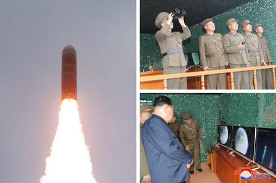 북한이 지난 2일 신형 잠수함발사탄도미사일(SLBM) '북극성-3형'을 성공적으로 시험발사했다고 조선중앙통신이 3일 보도했다. 조선중앙통신 홈페이지에 게재된 사진에서 김정식, 전일호, 장창하 등 북한 국방과학 부문 간부들이 발사를 지켜보는 모습. 인민복을 입고 고개를 돌린 사람은 이병철 당 군수공업부 제1부부장으로 추정된다.[연합뉴스]