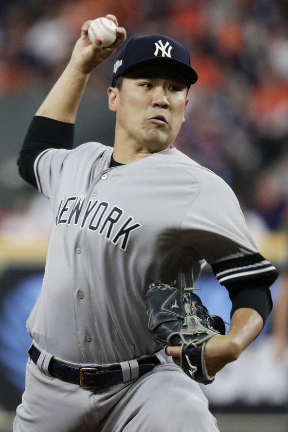 비로 하루 연기된 4차전에서 양키스 선발로 나서는 일본인 투수 다나카 마사히로. [AP=연합뉴스]