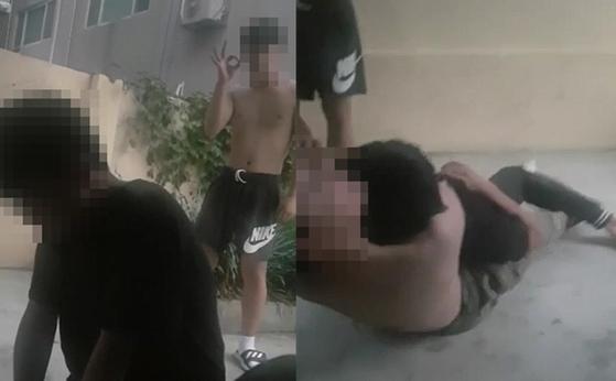 대전시 유성구의 한 중학교에 다니는 학생이 친구들에게 폭행을 당하는 장면. 가해 학생이 피해 학생의 목을 조르고 있다.(오른쪽) [사진 학부모 제공 동영상 캡처]