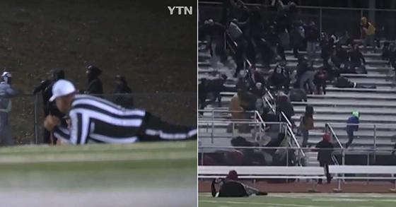 미국 동부 뉴저지주의 한 고등학교 미식축구 경기 중 들린 총성에 경기장 밖으로 대피하는 관중(오른쪽)과 경기장에 몸을 엎드린 심판. [YTN 영상 캡처]