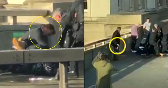 29일(현지시간) 영국 런던의 런던브릿지에서 발생한 흉기 테러 사건 때 용의자를 제압한 시민 가운데 한 명(왼쪽). 한 남성이 용의자로부터 빼앗은 것으로 보이는 흉기를 들고 뒤로 물러서 있다. [BBC 영상 캡처]