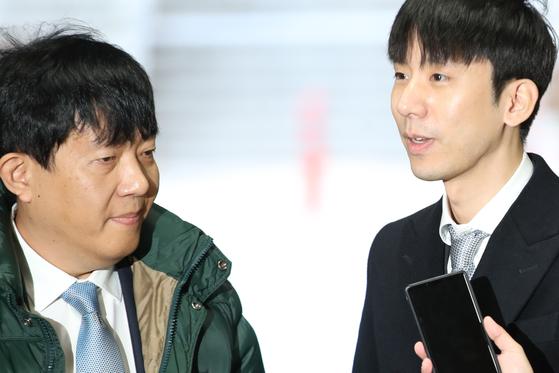 여객자동차 운수사업법 위반 혐의로 기소된 이재웅 쏘카 대표(왼쪽)와 타다 운영사 VCNC의 박재욱 대표. [연합뉴스]