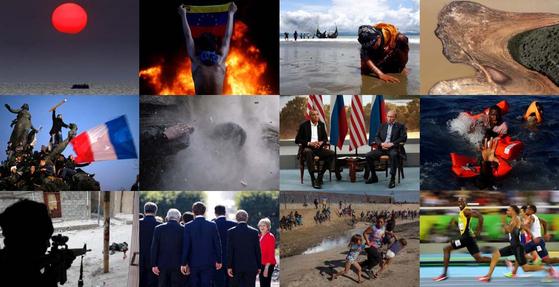 2010년부터 2019년까지 지난 10년간의 기록 사진이 다시 모습을 드러냈다. 아이티의 대지진에서 시리아 전쟁에 이르기까지 전세계 현장에서 로이터 기자가 촬영한 최고의 사진들을 지난 4일 보도했다. 무장 충돌, 자연 재해, 난민들의 고통 등 사진 한장 한장이 숨막히는 현장의 기록들이다. [로이터=연합뉴스]