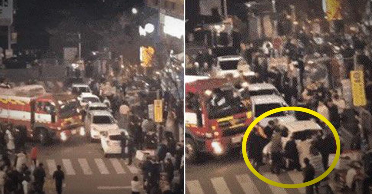 지난달 24일 오후 9시24분쯤 용인시 기흥구의 한 음식점에서 불이 났을 당시 거리의 시민들이 소방차의 현장 진입을 도왔다. [사진 경기도소방재난본부]