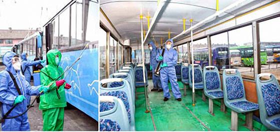 북한 노동당 기관지 노동신문이 지난 12일 공개한 사진으로, 함흥시에서 방역요원들이 버스 내부까지 소독작업을 벌이고 있는 모습. [연합뉴스]