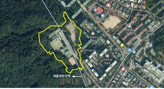 서초구 우면동의 전 한국교육개발원 건물과 주차장의 모습. 건물이 들어선 땅이 그린벨트로 묶여 있다.