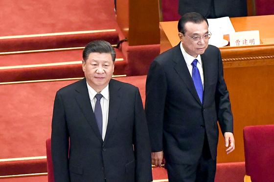 지난 5 월 21 일 전국 인민 정치 협상 회의 개회식에 참석 시진핑 국가 주석 (왼쪽)과 李克 강 총리. [AFP]