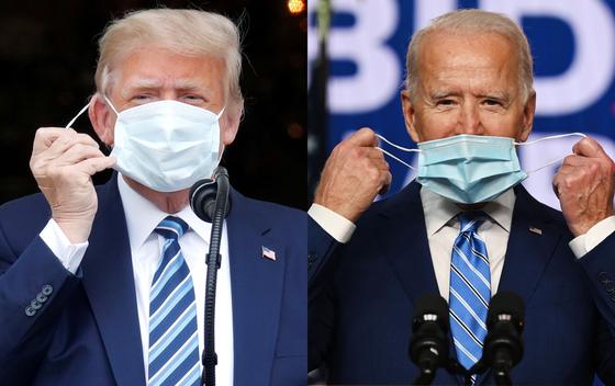 도널드 트럼프 미국 대통령(왼쪽)과 조 바이든 미국 대통령 당선자가 각각 마스크를 쓰려고 하고 있다. 내년 1월 20일로 예정된 미 대통령 취임식에 전임자인 트럼프 대통령이 불참할 가능성이 미 조야에서 제기되고 있다. [AFP·로이터=연합뉴스]