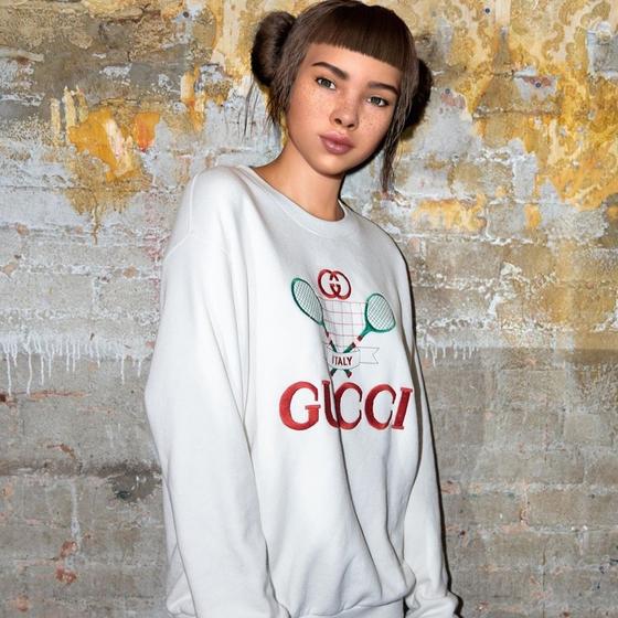 구찌 로고 티셔츠를 입은 가상 인간 '릴 미켈라'. 그의 인스타그램 팔로워 수는 289만 명이다. 포스팅 한 개에 받는 마케팅 비용만 1000만원에 달한다. 사진 인스타그램