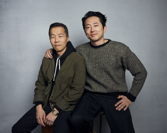 Director Jeong Isak and Steven Yoon of the movie'Minari' posing together at last year's Sundance Film Festival.  The two are related.  AP=Yonhap News