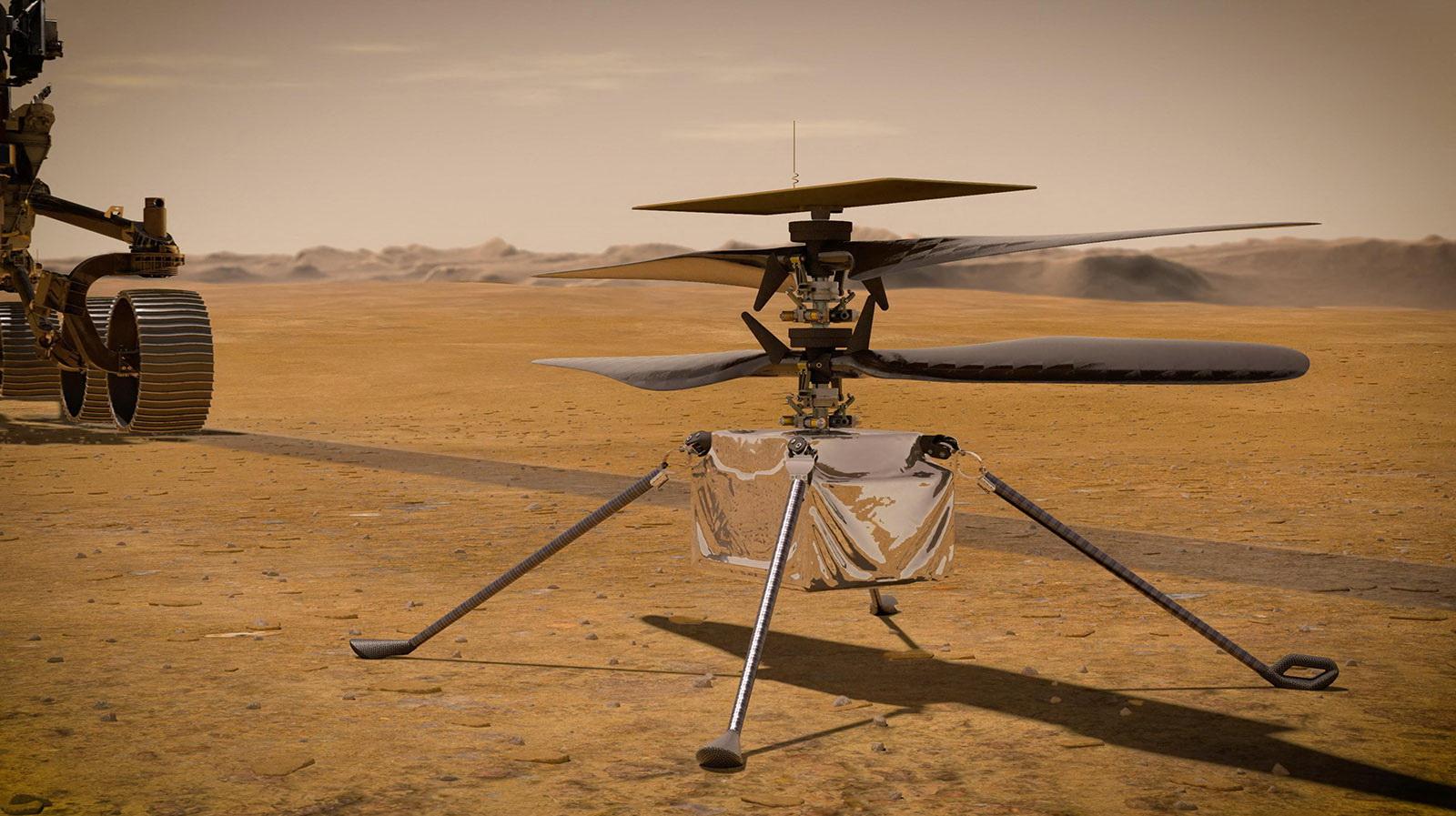 나사에서 제공한 화성 탐사 소형 헬기 '인저뉴어티' 상상도. 위에 태양광 패널이 부착되어 있다. 비행을 위한 전력을 충전한다. 2중으로 설계된 날개는 길이가 1.2m. 그 아래 본체에는 카메라와 센서가 부착되어 있다. 인저뉴어티의 비행고도는 최대 5m, 활동반경은 최대 300m다. 지구에서는 무게가 1.8kg이지만 화성은 중력이 지구의 3분의 1 정도라 화성 중력은 0.68kg이다. AFP=연합뉴스