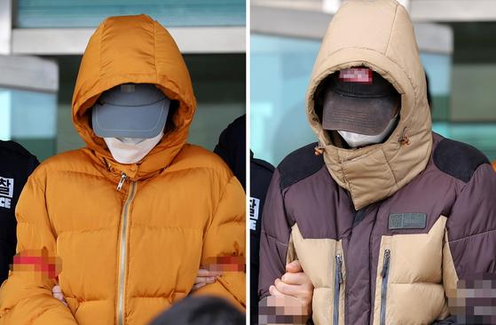 생후 2주 된 아들을 폭행해 살해한 혐의로 구속 송치된 남편 A(24·오른쪽)씨와 아내 B(22)씨가 지난 2월 전북 전주덕진경찰서 유치장에서 걸어 나오고 있다. 연합뉴스