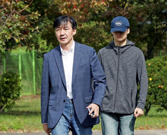 조국 전 법무부 장관과 아들 조모씨. 뉴스1