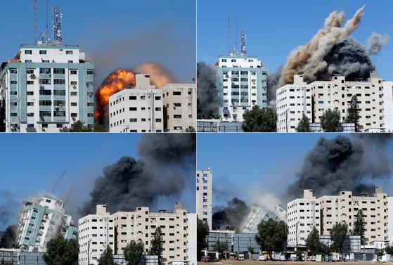 15일(현지시간) 이스라엘군의 공습으로 가자지구 내 AP통신 등 외신이 입주한 건물이 붕괴되고 있다. [로이터=연합뉴스]