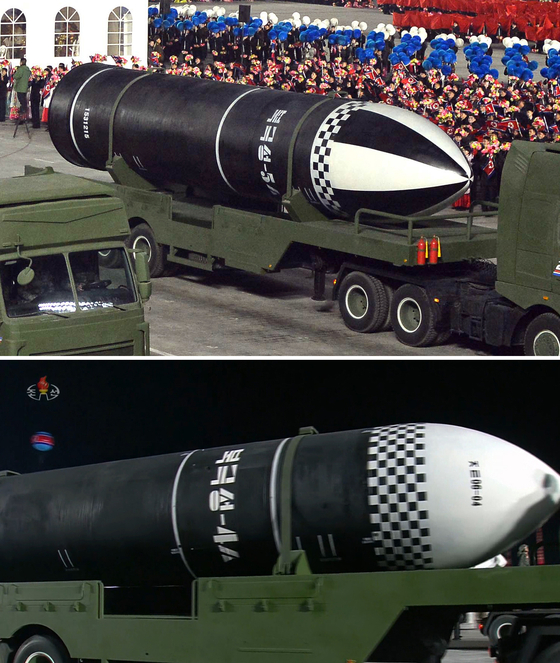 """A new submarine-launched ballistic missile (SLBM) with a phrase that looked like """"Bukguksong-5s (Siot)"""" appeared at the parade commemorating the 8th Party Congress in Pyongyang, North Korea, in January.  The length of the fuselage was similar to that of the 'Bukgukseong-4ㅅ' (below), which was unveiled at the military parade to celebrate the 75th anniversary of the founding of the Party on October 10 last year, while the warhead was enlarged.  Photo captured by Chosun Central TV."""