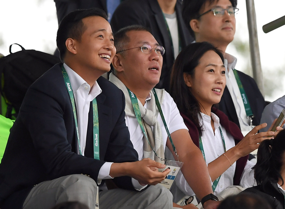 Kim Dong-gwan, CEO of Hanwha Solutions (far left), in 2016.  Central photo