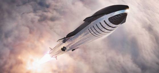 스페이스X의 우주선 스타십이 1단 로켓 슈퍼헤비에 실려 대기권을 뚫고 우주로 치솟고 있다. 위쪽 띠처럼 보이는 부분이 승객들이 타는 공간이다. [사진 스페이스X]