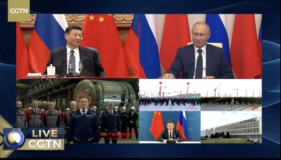 시진핑(習近平) 중국 국가주석과 블라디미르 푸틴 러시아 대통령이 지난 5월 19일 오후 6시(한국시간) 베이징과 모스크바에서 화상 연결을 통해 중·러 원전 협력 프로젝트 착공식을 참관하고 있다.
