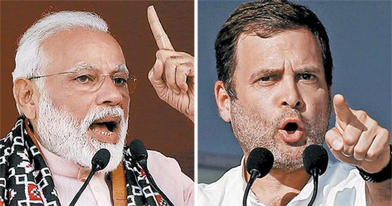 오는 11일 인도 총선에서 맞대결을 펼치는 하층민 출신의 나렌드라 모디 총리(왼쪽)와 네루-간디 가문의 라훌 간디(오른쪽). [AP·로이터=연합뉴스]