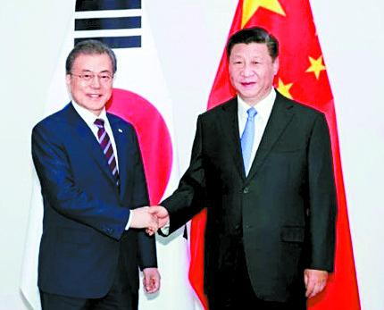 중국 인민일보는 지난 27일 한·중 정상회담을 보도하며 '중·한 협력이 외부 압력의 영향을 받아선 안 된다'는 시진핑 주석 발언을 제목으로 뽑았다. [사진 중국 인민망 캡처]